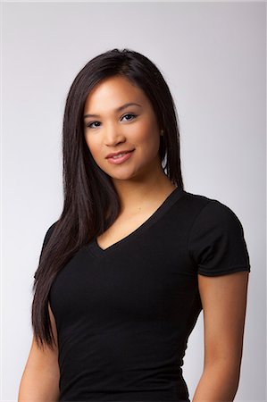 filipina - Young woman smiling Stock Photo - Premium Royalty-Free, Code: 618-06406102