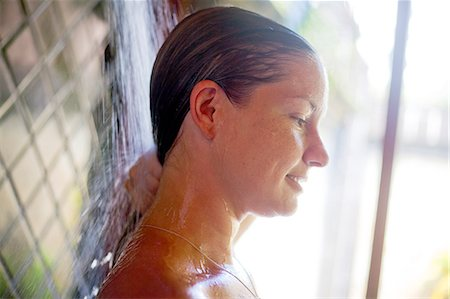 shower - A young girl showering in a outdoor shower. Stock Photo - Premium Royalty-Free, Code: 618-06406195