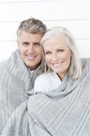 Senior Couple Wrapped In Blanket Stock Photo - Premium Royalty-Free, Code: 618-06436493