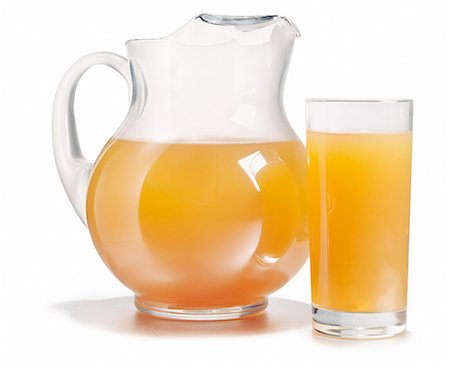 Pitcher and glass full of fresh orange juice Stock Photo - Premium Royalty-Free, Code: 618-06436580