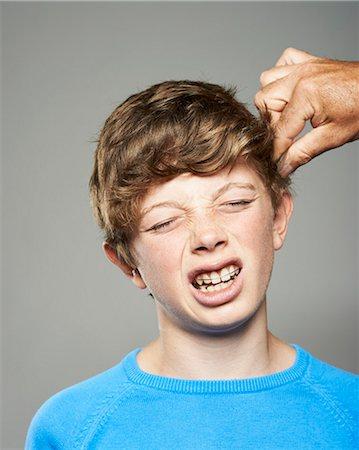 teenage boy having hair pulled Stock Photo - Premium Royalty-Free, Code: 618-06436619