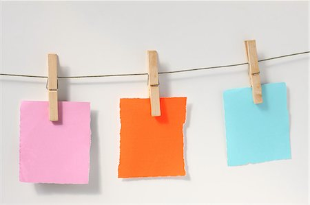 self adhesive note - Blank notes on laundry clothesline Stock Photo - Premium Royalty-Free, Code: 618-06436660