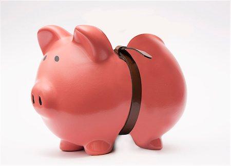 piggybank tightening the belt Stock Photo - Premium Royalty-Free, Code: 618-06436682
