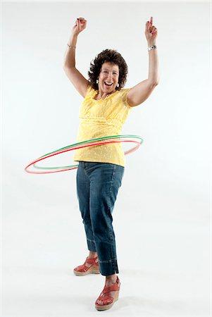Mature Women Hula Hooping Stock Photo - Premium Royalty-Free, Code: 618-06436723