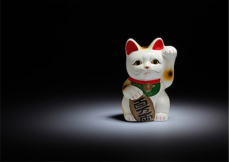Maneki-neko cat Stock Photo - Premium Royalty-Free, Code: 618-06436748