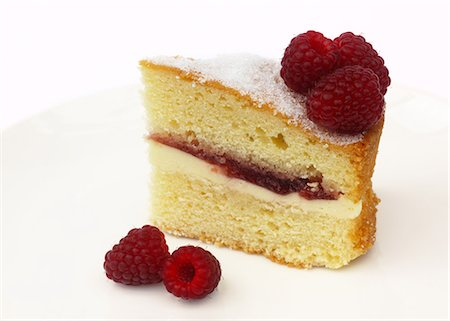 self indulgence - Tempting slice of Victoria sponge with raspberries Stock Photo - Premium Royalty-Free, Code: 618-06504228