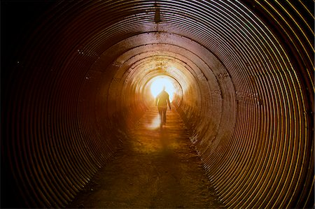 A young women walking inside a tunnel. Stock Photo - Premium Royalty-Free, Code: 618-06504241