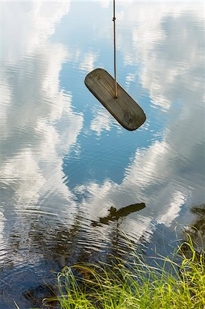 swing (sports) - Rope swing over lake Stock Photo - Premium Royalty-Free, Code: 618-06503902