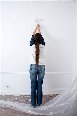 painting - Young Woman Painting Wall With Roller Stock Photo - Premium Royalty-Free, Code: 618-06503988