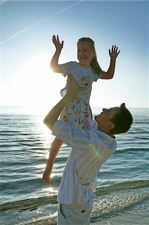 preteen girl - father and daughter on the beach Stock Photo - Premium Royalty-Free, Code: 618-06538805