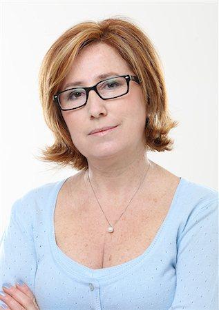 Portrait of woman wearing glasses Stock Photo - Premium Royalty-Free, Code: 618-06538913