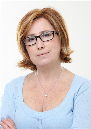 Portrait of woman wearing glasses Stock Photo - Premium Royalty-Free, Code: 618-06538913