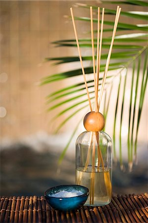 Scent bottle with sticks and flower in outdoor spa Stock Photo - Premium Royalty-Free, Code: 618-06539055