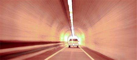 Car driving through tunnel Stock Photo - Premium Royalty-Free, Code: 618-06617963