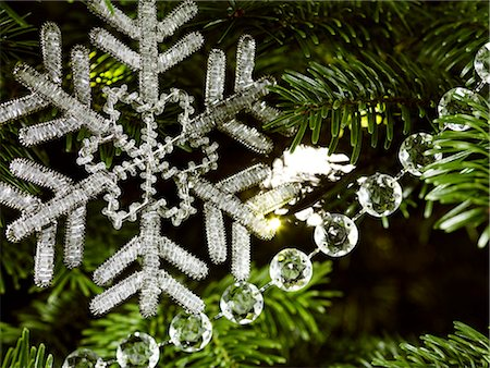 snowflakes  holiday - Beaded snowflake decoration close up Stock Photo - Premium Royalty-Free, Code: 618-06618212