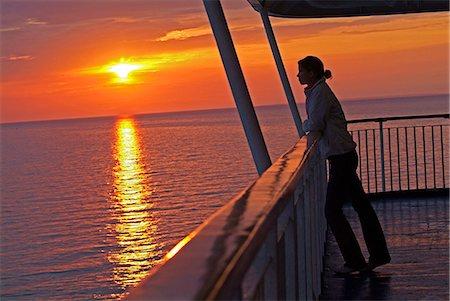 woman at sunset on cruise ship Stock Photo - Premium Royalty-Free, Code: 618-06618382