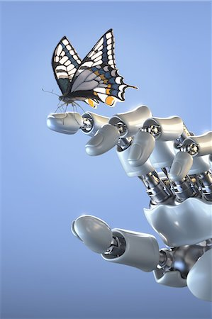 Butterfly standing on fingertip of a robot hand Stock Photo - Premium Royalty-Free, Code: 618-06818525