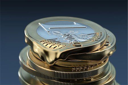 One euro coin becomes soft and liquid Stock Photo - Premium Royalty-Free, Code: 618-06818559