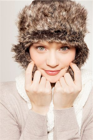 fur - Portrait of young woman in fur hat holding flask Stock Photo - Premium Royalty-Free, Code: 618-06836602