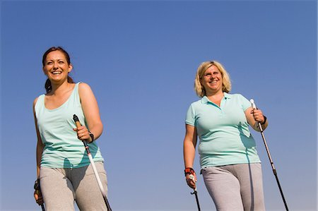 Two friends hiking against blue sky Stock Photo - Premium Royalty-Free, Code: 618-06836746