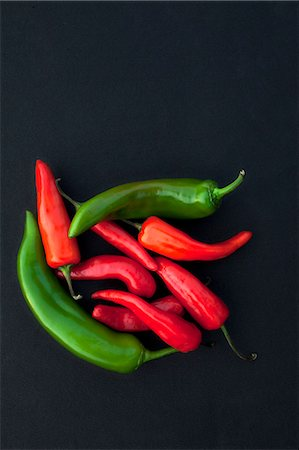 Red Chili & Green Chili, Black background Stock Photo - Premium Royalty-Free, Code: 618-07073263