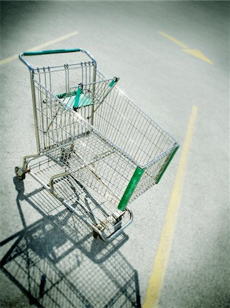 empty shopping cart - Vignette of empty shopping cart in parking lot Stock Photo - Premium Royalty-Free, Code: 618-07385028
