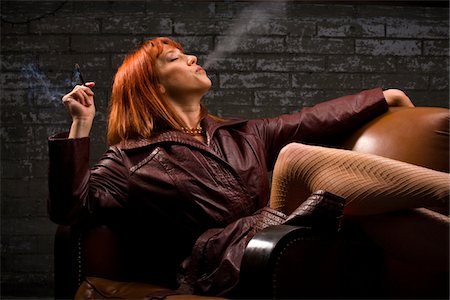 Redhead Smoking a Clove Stock Photo - Premium Royalty-Free, Code: 618-07389957