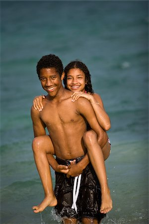 Brother and Sister piggy back in ocean Stock Photo - Premium Royalty-Free, Code: 618-07396437