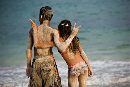 Couple doing peace sign while boy looks away Stock Photo - Premium Royalty-Free, Code: 618-07396438