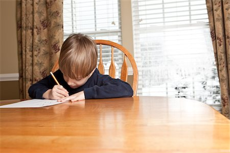 Child Working On Homework Stock Photo - Premium Royalty-Free, Code: 618-07401067