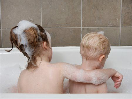 Young girl in tub with baby boy. Stock Photo - Premium Royalty-Free, Code: 618-07401255