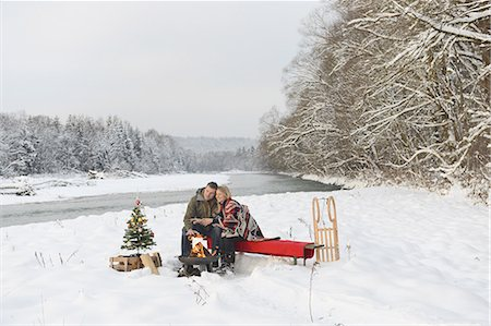 snow christmas tree white - Couple sitting at campfire in snow Stock Photo - Premium Royalty-Free, Code: 618-07612094