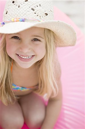 Portrait of young girl smiling Stock Photo - Premium Royalty-Free, Code: 618-07612131