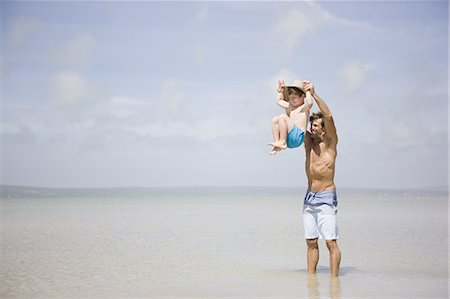 Father lifting boy above sea Stock Photo - Premium Royalty-Free, Code: 618-07612152