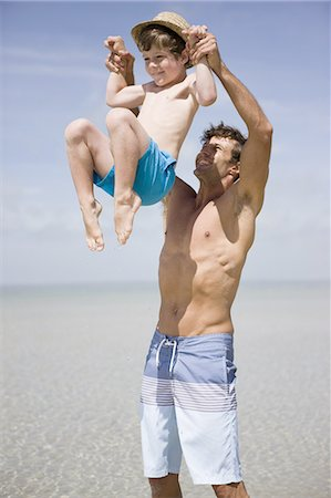 Father lifting boy above sea Stock Photo - Premium Royalty-Free, Code: 618-07612153