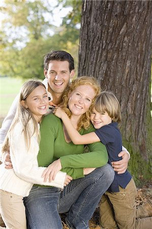 Portrait of family in autumn forest Stock Photo - Premium Royalty-Free, Code: 618-07612198