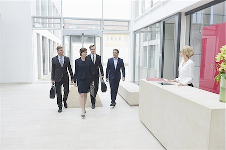 Business people arriving in offices Stock Photo - Premium Royalty-Free, Code: 618-07612210
