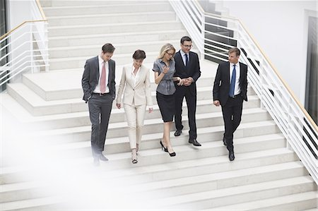 Business colleagues using staircase Stock Photo - Premium Royalty-Free, Code: 618-07612249