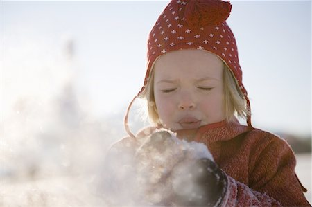 Girl blowing snow, close up Stock Photo - Premium Royalty-Free, Code: 618-07612282