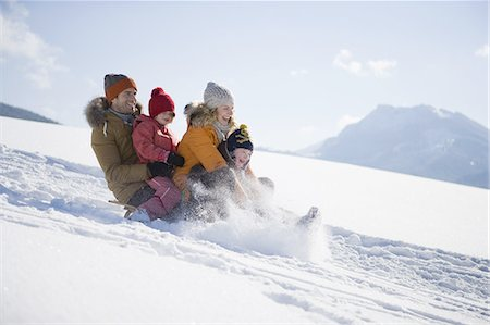 people and vacation - Family tobogganing on snow Stock Photo - Premium Royalty-Free, Code: 618-07612292