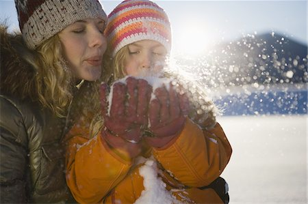Mother and girl blowing snow Stock Photo - Premium Royalty-Free, Code: 618-07612302
