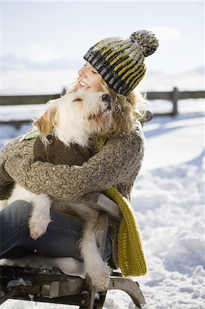 dog and woman and love - Woman embracing pet dog in snow Stock Photo - Premium Royalty-Free, Code: 618-07612315