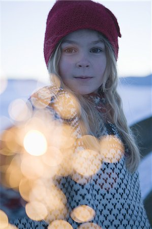 Girl holding sparkler in snow Stock Photo - Premium Royalty-Free, Code: 618-07612330