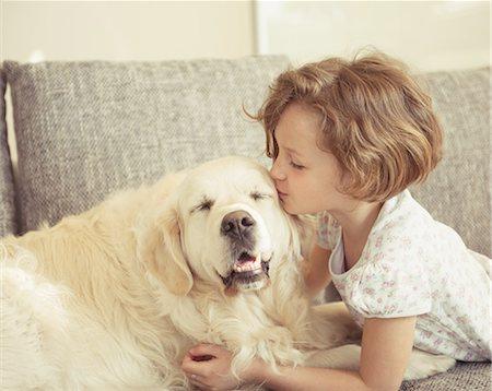 dog kissing girl - Young girl kissing pet dog Stock Photo - Premium Royalty-Free, Code: 618-07612342