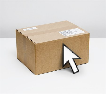 Parcel and mouse pointer Stock Photo - Premium Royalty-Free, Code: 618-07653857
