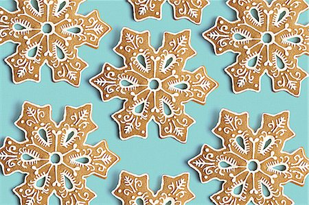 snowflakes  holiday - Cookie shaped as a snowflake with fancy decoration Stock Photo - Premium Royalty-Free, Code: 618-07732998
