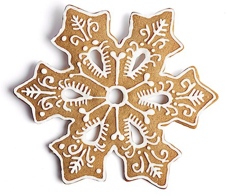 snowflakes  holiday - Cookie shaped as a snowflake with fancy decoration Stock Photo - Premium Royalty-Free, Code: 618-07733001