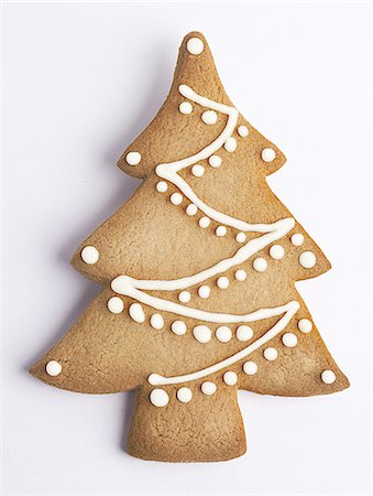 Cookie shaped as a Christmas tree with decoration Stock Photo - Premium Royalty-Free, Code: 618-07733003