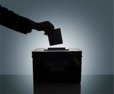 Silhouette of man casting his vote Stock Photo - Premium Royalty-Free, Code: 618-08067204