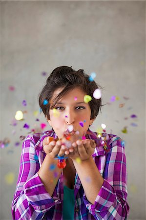 decoration pattern - Teen girl blowing confetti Stock Photo - Premium Royalty-Free, Code: 618-08063739